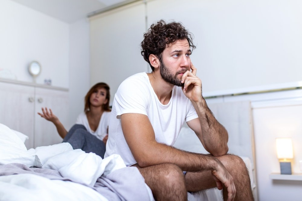 man with low self confidence in bed