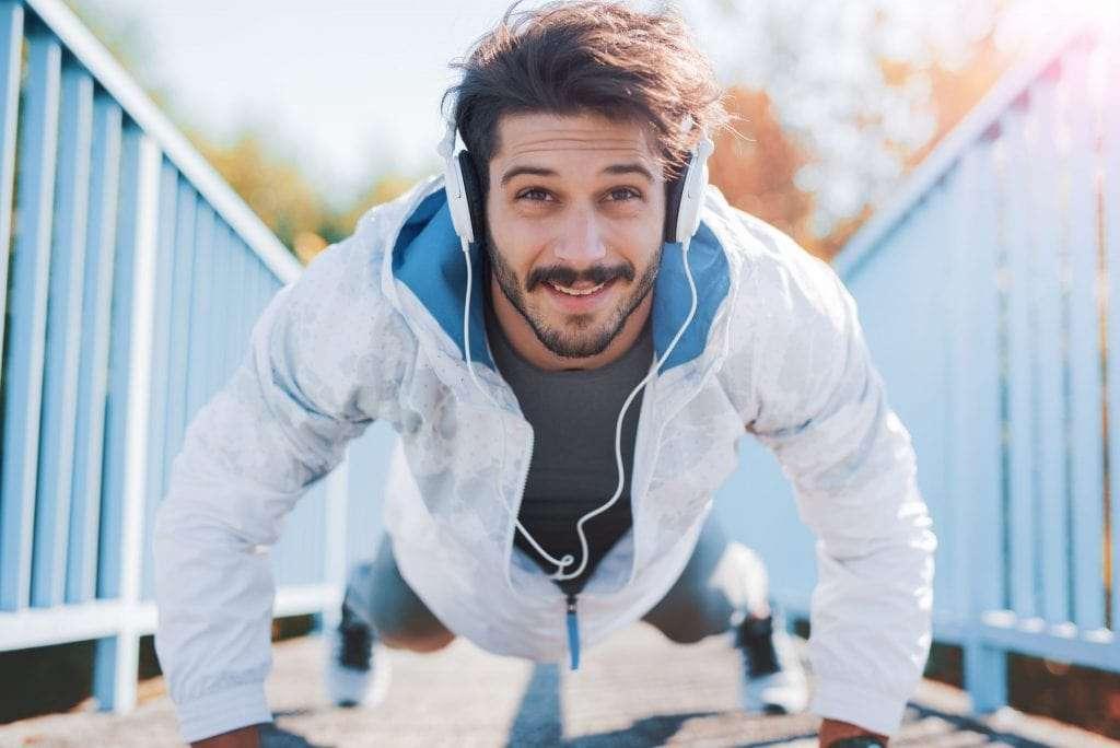 athletic man looking hopeful