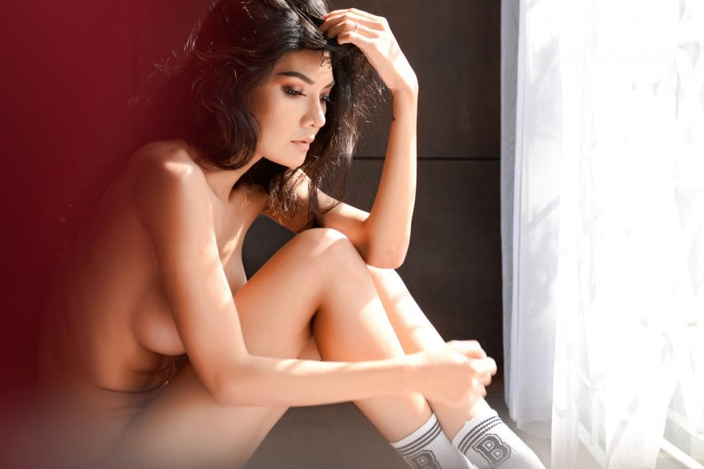 naked woman having a pensive moment