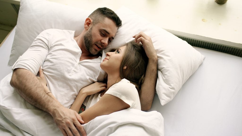 couple having moment in bed