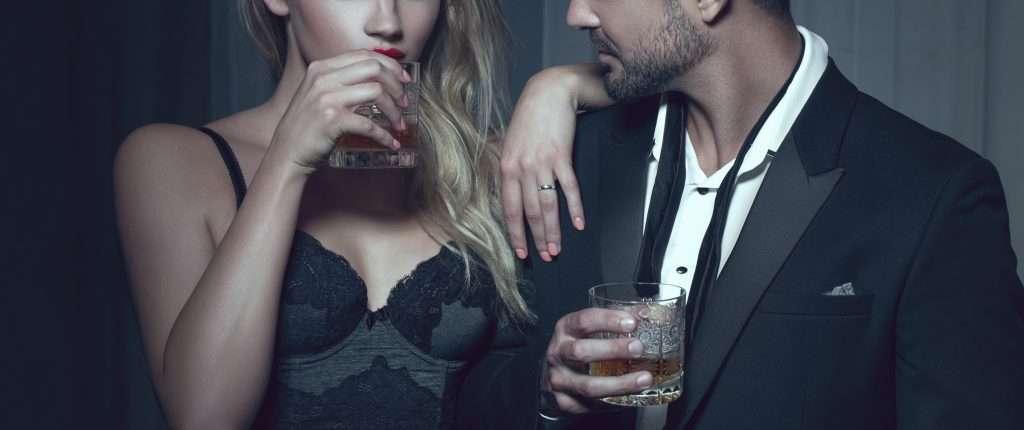 fancy couple having drinks