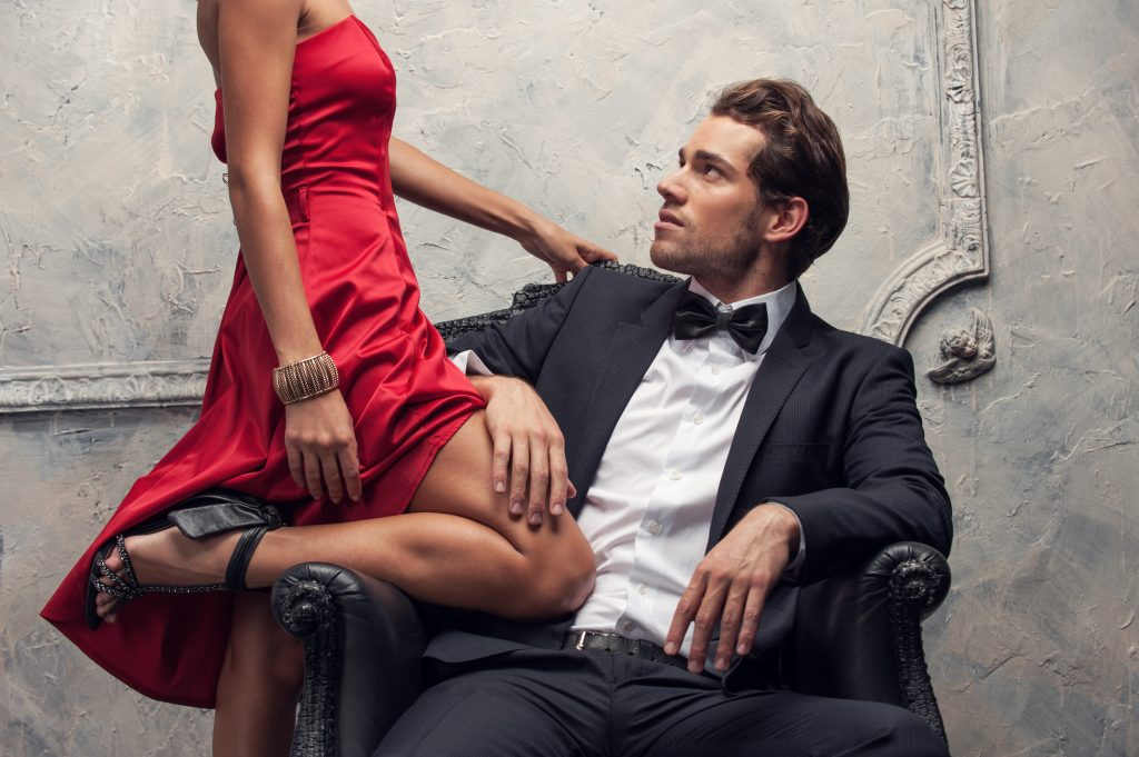 formal couple in foreplay