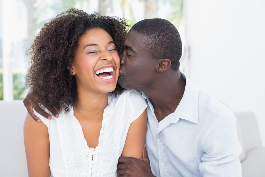 happy couple kissing and laughing