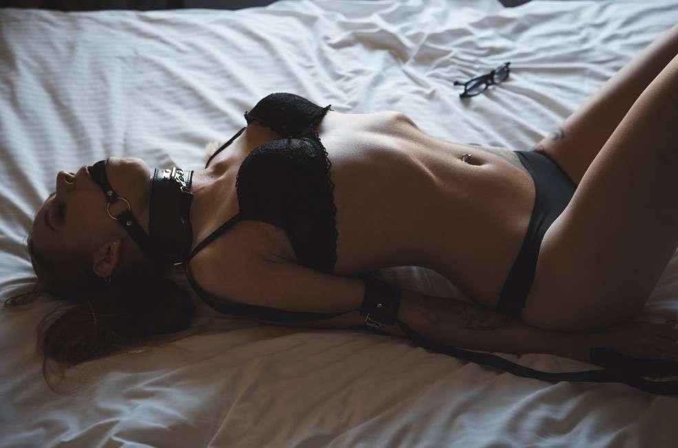 BDSM woman with gag ball