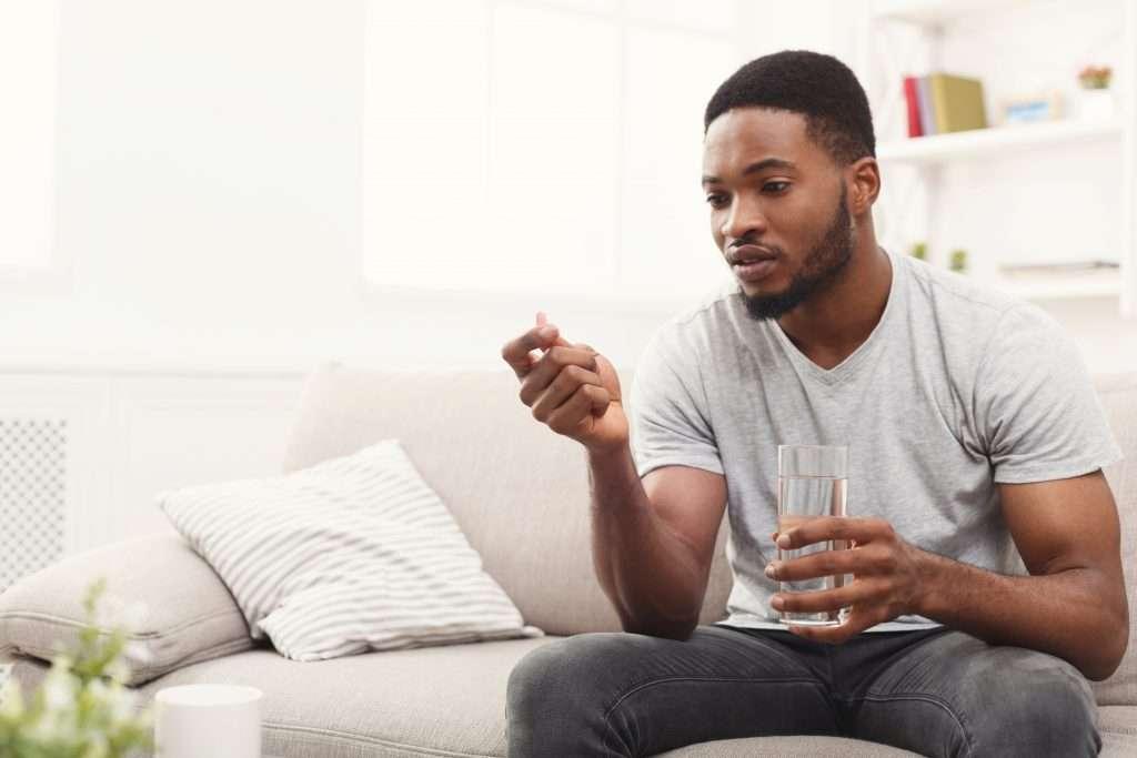 man looking at medication