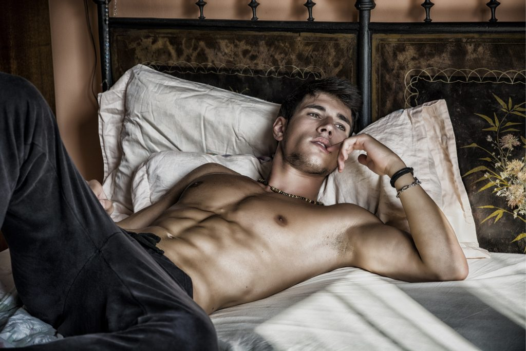 sexy shirtless man in bed