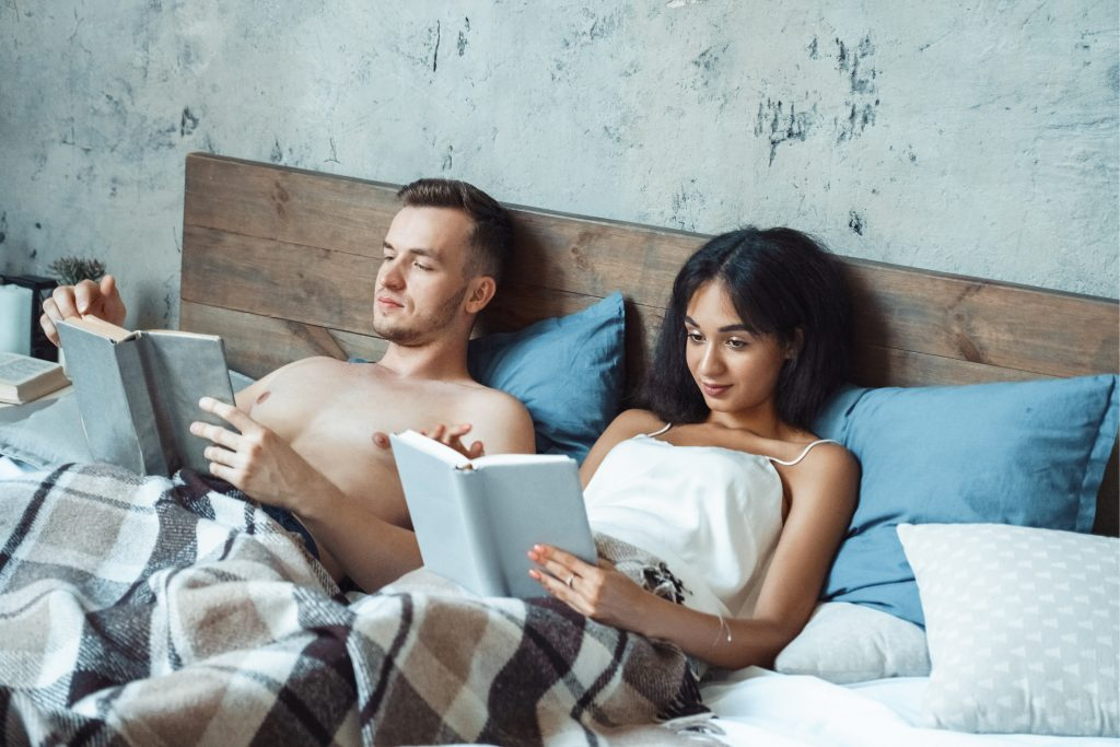 couple reading in bed together