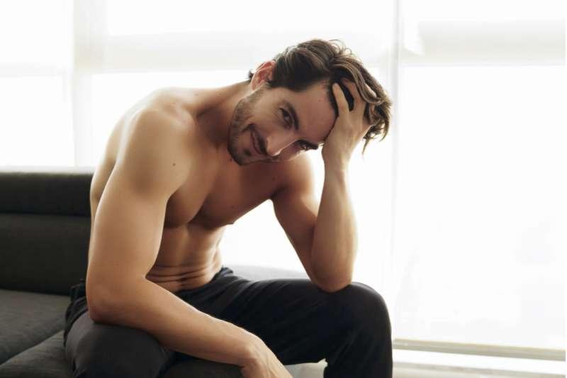 shy shirtless man