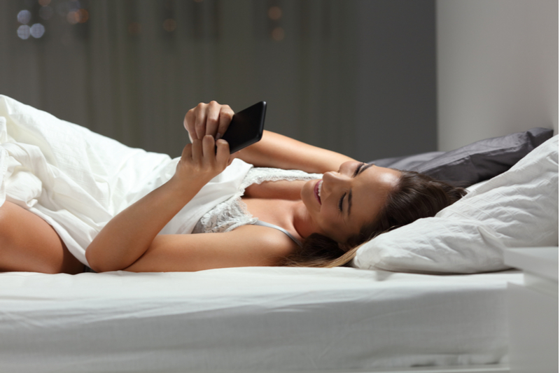 Girl texting from bed