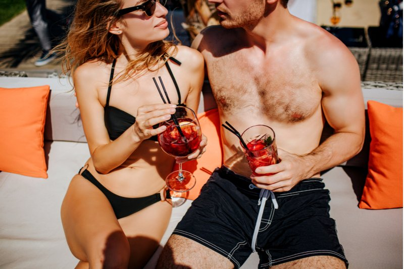 man lounging with woman - how to stop being the nice guy