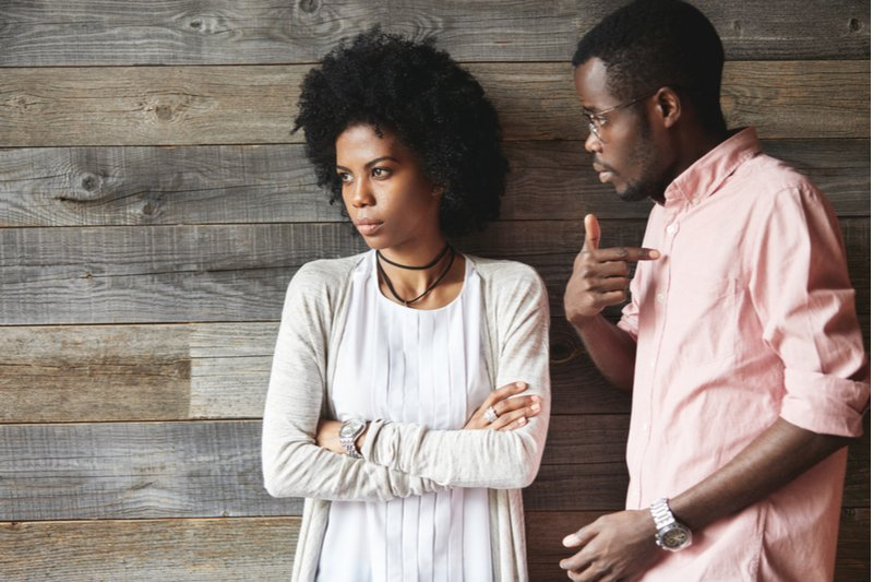 Man and woman arguing. Man is playing the victim and the woman is not attracted to his mindset.