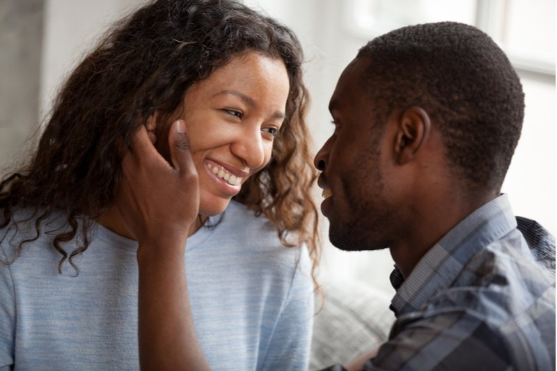 Man is touching his partners face. Signs a woman is sexually attracted to you