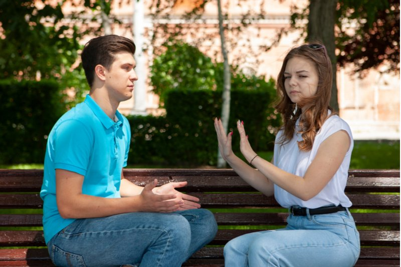 man asking invasive question to woman